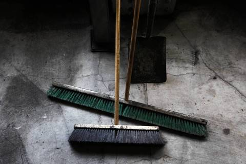 Brooms in the conveyer area that brings coal into Fisk Generation Station coal fired power plant tour.