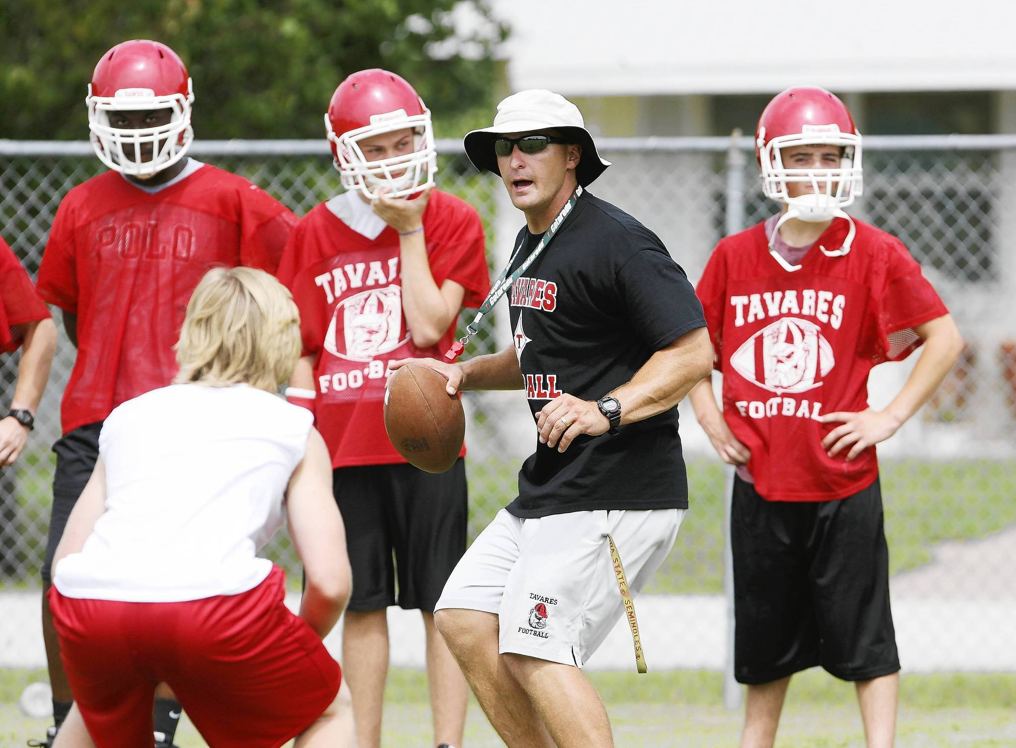 Tavares coach Chris Gauntlett drills players on Tuesday, August 7, 2012. Practice got under way this week for high school teams.  (Tom Benitez/Orlando Sentinel)
