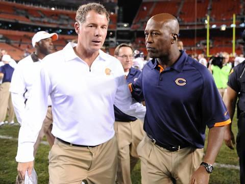 Browns head coach Pat Shurmur and Bears coach Lovie Smith talk after their preseason game at Cleveland Browns Stadium.