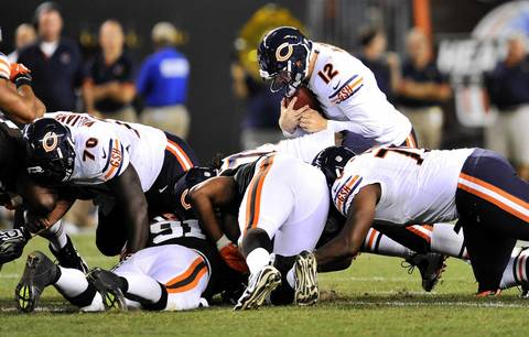 Quarterback Josh McCown is stopped on a fourth down run in the fourth quarter.