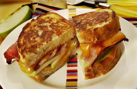 Grilled English Cheddar sandwich with smoked bacon and apple.
