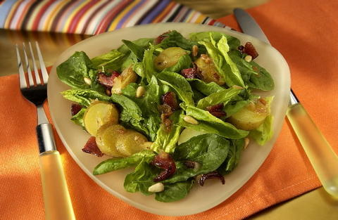 Spinach salad with warm bacon dressing.