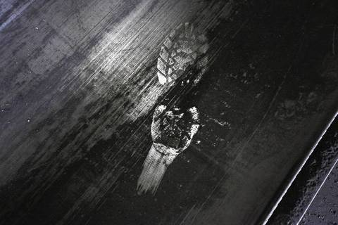 A single boot print on a coal conveyer at the Midwest Generation Fisk Generating Station coal fired power plant one day before its closing.