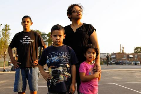 Kim Wasserman, director of the Little Village For Environmental Justice and her children Anthony, 14, Peter, 7, and Gabriela, 4. Wasserman's three children have asthma that their mother says is the result of the coal plants. Wasserman was a huge part of the grassroots community organization that pressured the city to close the plants.