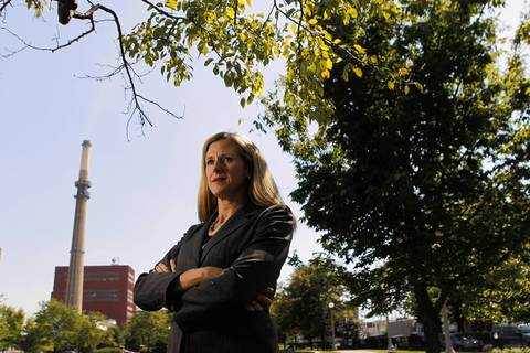 """Faith Bugel, senior attorney for the Environmental Law & Policy Center, seen here at Dvorak Park in Chicago's Pilsen neighborhood. Bugel had been quietly working behind the scenes for more than a decade. The day she heard the company announce that the plants would close she said """"""""That day I knew exactly what it felt like to do drugs. The high was so high. It was like nothing I''ve ever felt before in my life."""""""""""