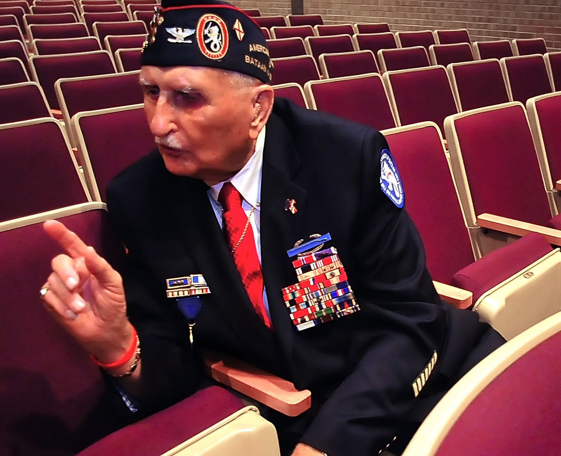 Col. Glenn Frazier describes his military experiences Friday at Greencastle-Antrim High School. In World War II Frazier fought in the Phillipines, survived the Bataan death march, three years of imprisonment and torture in Japanese prison camps.