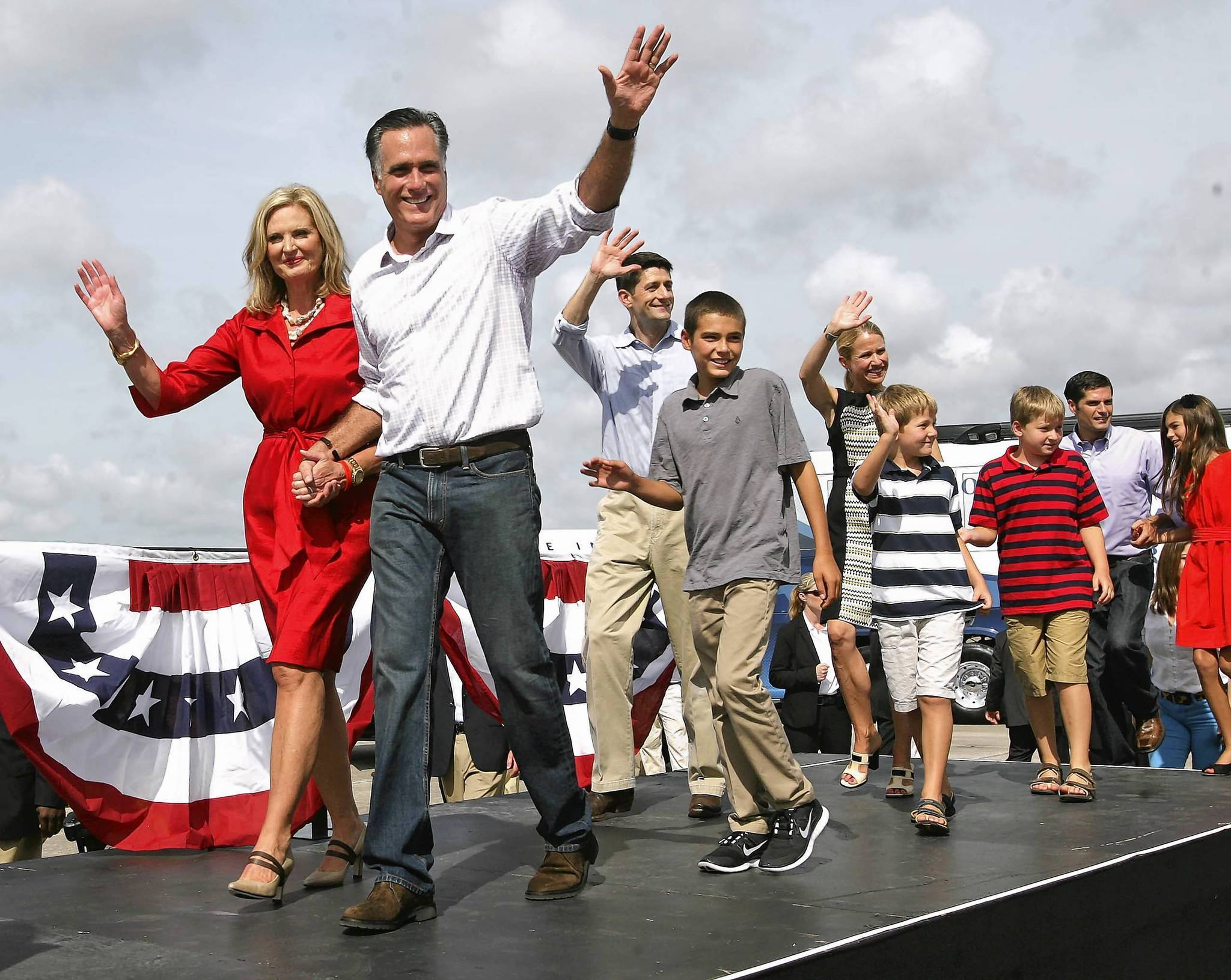 The Romneys and Ryans wave to cheering supporters at the end of a send-off rally on the tarmac at the airport in Lakeland, Fla., Friday, August 31, 2012.