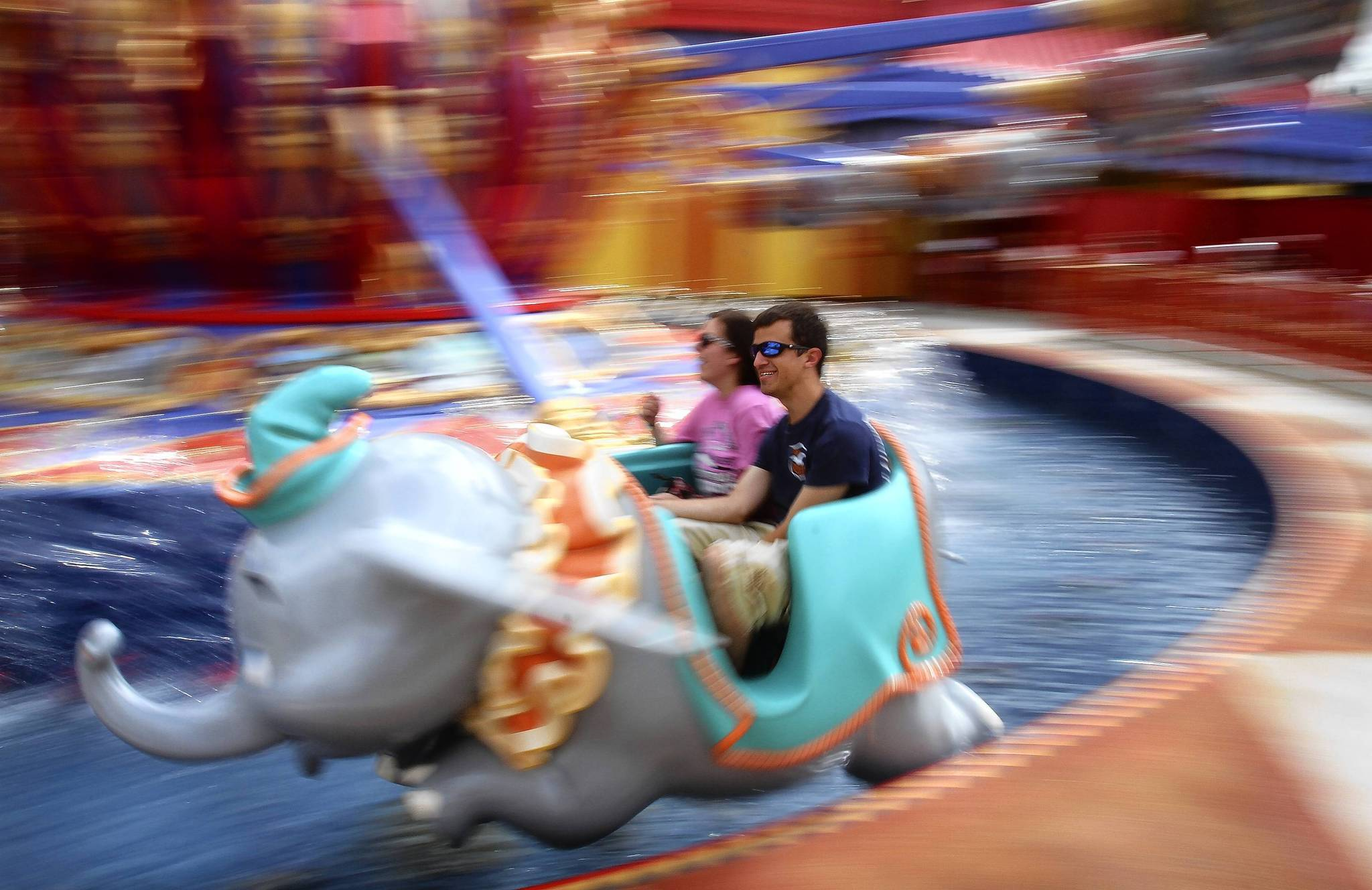 Guests ride Dumbo the Flying Elephant during the soft opening of the first phase of the Fantasyland expansion at Disney's Magic Kingdom.