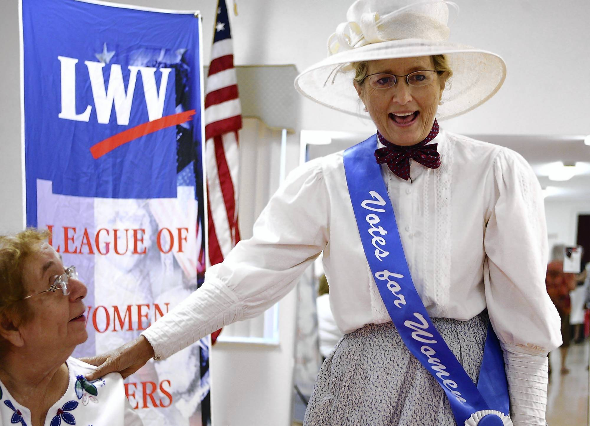 Deirdre Macnab, president of the League of Women Voters of Florida, greets league members at the Lady Lake Community Building on Friday, August 24, 2012. Macnab is dressed as women's suffragist Susan B. Anthony. (Stephen M. Dowell/Orlando Sentinel)