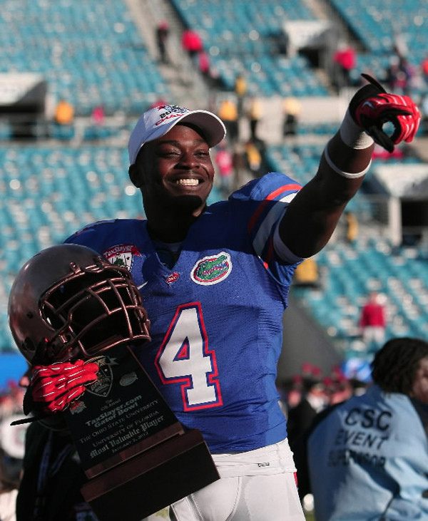 Florida wide receiver and Seminole High School graduate Andre Debose accepts the MVP trophy after the Gators' 24-17 over Ohio State in the Gator Bowl in Jacksonville, Florida, on Monday, January 2, 2012.