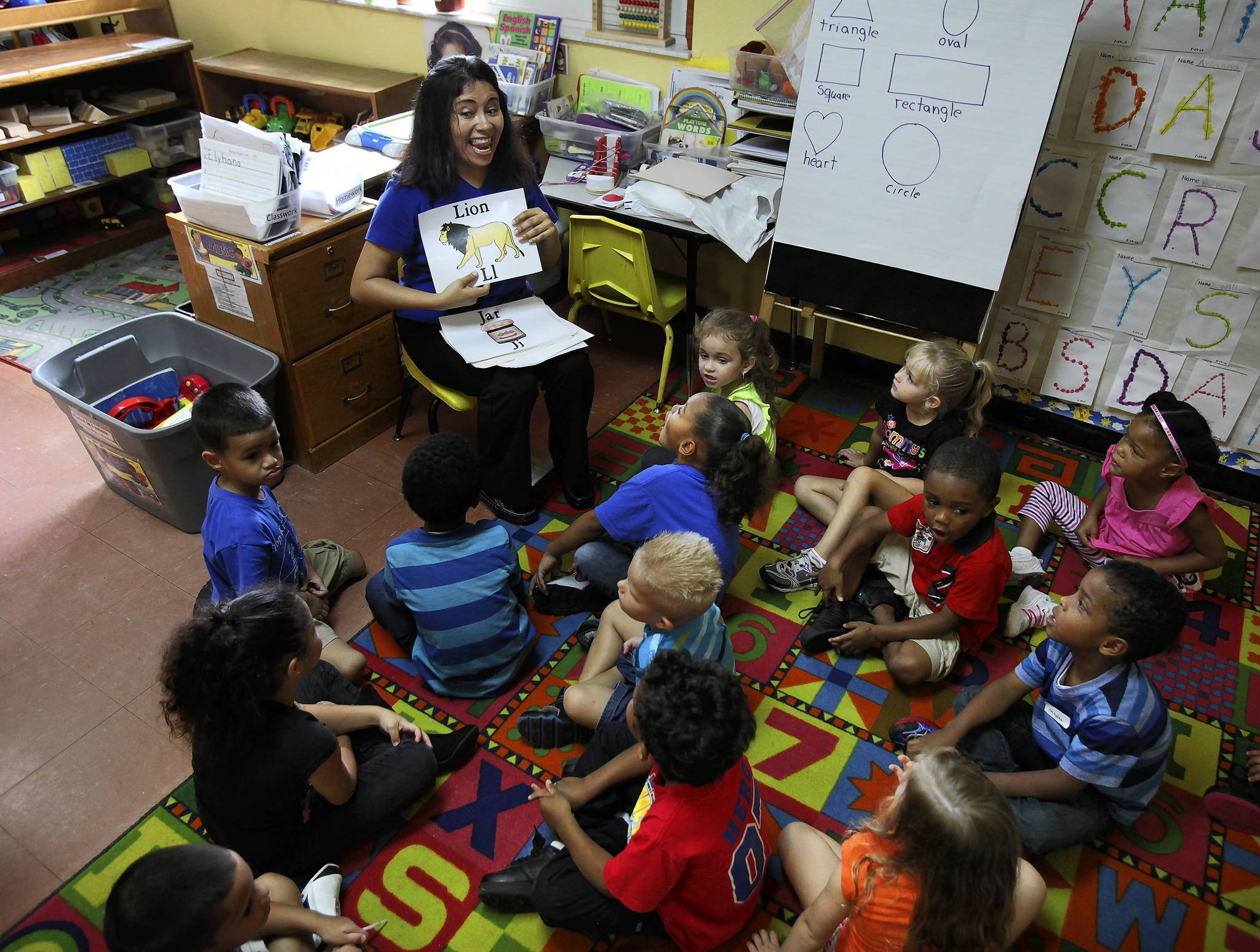 VPK teacher Leyla Villagran leads an exercise with her students at Top Kids Academy in Orlando on August 29, 2012.