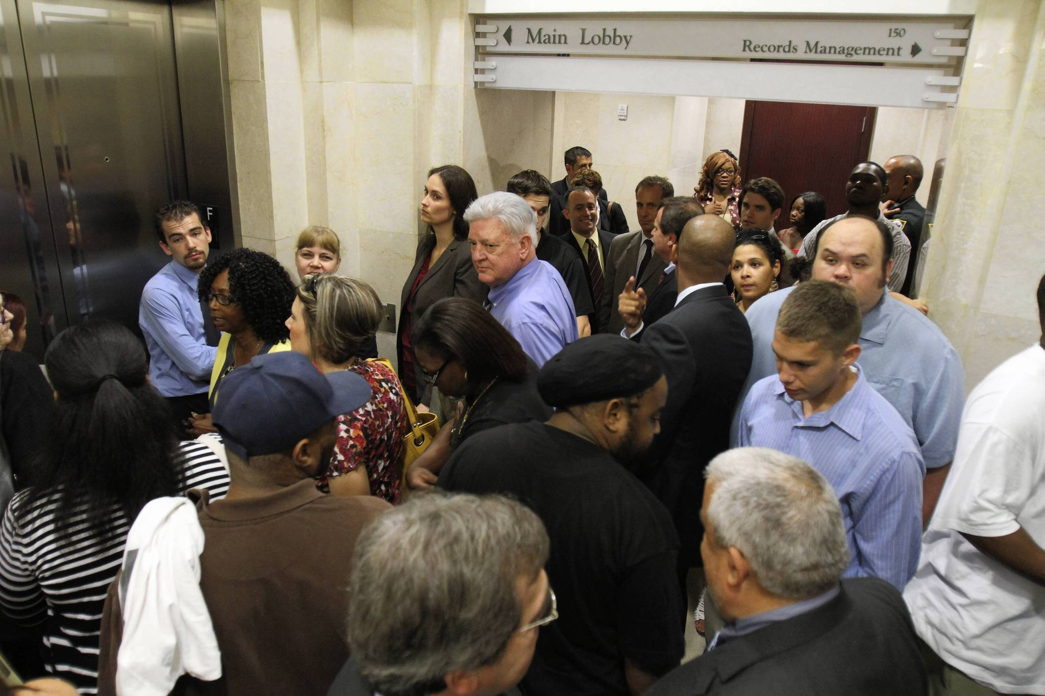 people in elevator. the orange county courthouse elevators are jammed with people waiting to get on and off in elevator l