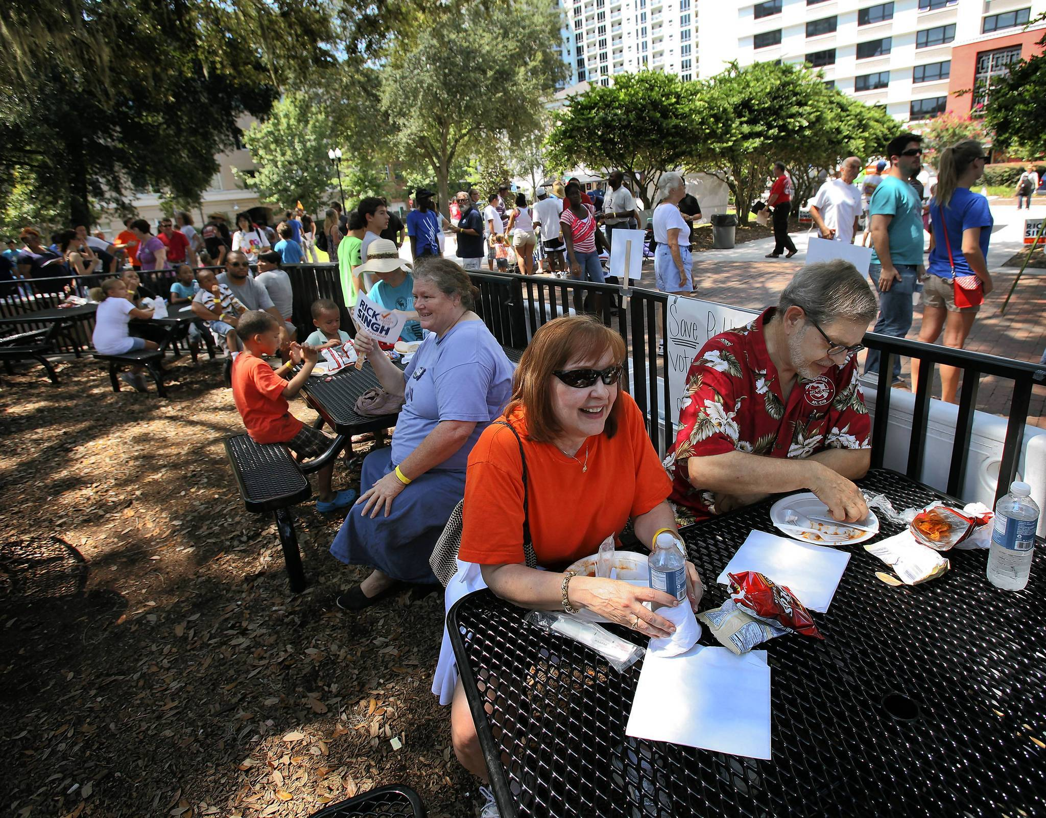 Carol and Bill Barnes eat and listen to people speaking at Lake Eola Park on on September 3, 2012, during the Central Florida Labor Council Labor Day Picnic & Rally. Bill is the President of the IATSE Local 631, International Alliance of Theatrical Stage Employees.