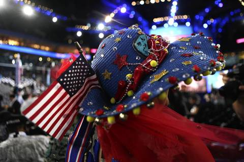 Carla Arellanes, from New Mexico, wears an exotic homemade hat on the first day of the Democratic National Convention.