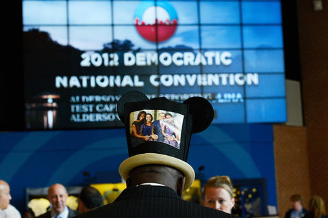 Edgar Baker of the U.S. Virgin Islands wears a hat with a portrait of Democratic presidential candidate, U.S. President Barack Obama and family during day one of the Democratic National Convention at Time Warner Cable Arena on Tuesday in Charlotte, North Carolina. The DNC that will run through September 7, will nominate U.S. President Barack Obama as the Democratic presidential candidate. (Photo by Kevork Djansezian/Getty Images) ORG XMIT: 151132341