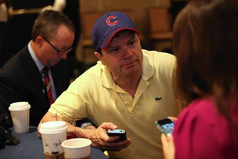 Rep. Mike Quigley (D-Ill.) wears casual attire as he chats with fellow delegates at the Illinois breakfast delegation meeting in Charlotte, N.C. on Tuesday.