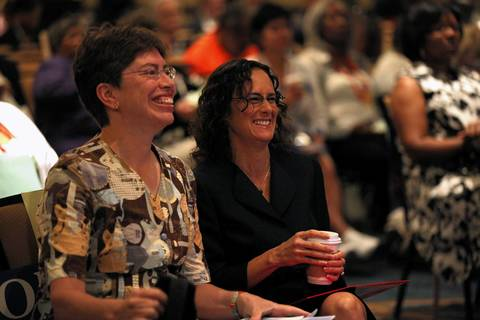 Lt. Gov. Sheila Simon and Attorney General Lisa Madigan share a laugh at the Illinois delegation meeting Tuesday in Charlotte N.C.