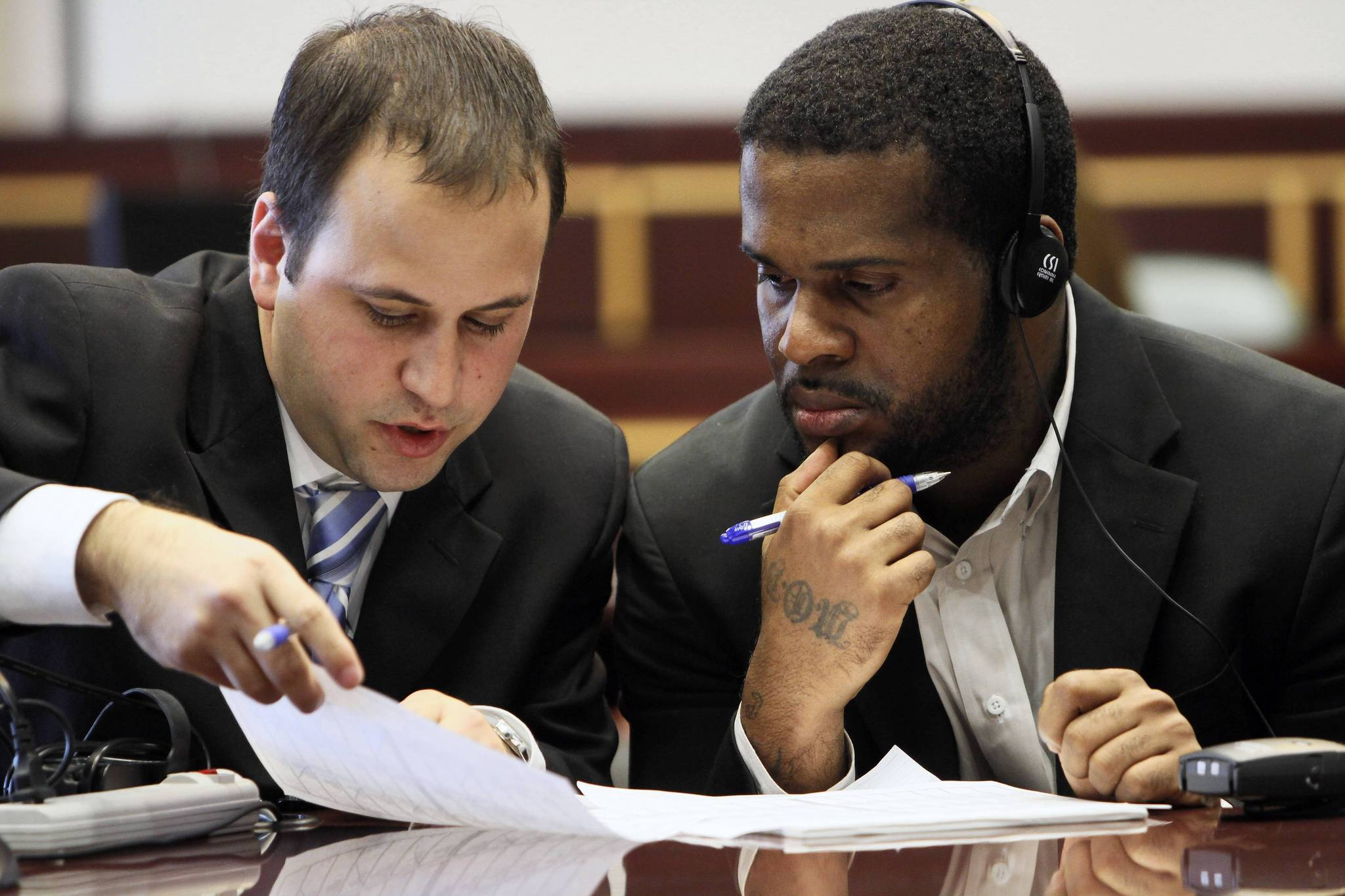 Left to Right, Attorney Josh Meyer and Jean Touze confer during the jury selection for his trial at the Orange County Courthouse, on Monday, September 4, 2012.