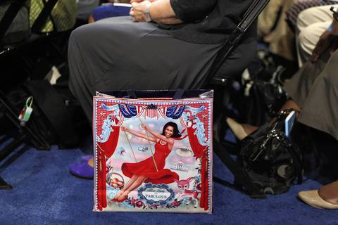 A bag with an image of Michelle Obama sits beside a delegate during Illinois Gov. Pat Quinn's speech.