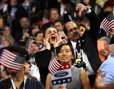 Delegates from Michigan boo as Ohio Governor Ted Strickland mentions Mitt Romney during his speech.