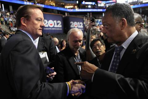 Former Obama press secretary Robert Gibbs chats with Jesse Jackson on the convention floor.