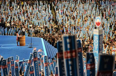 First Lady Michelle Obama speaks to the crowd on the first day of the Democratic National Convention.