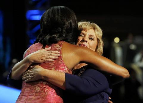 First lady Michelle Obama hugs Elaine Brye, who introduced her, before addressing the first session of the Democratic National Convention in Charlotte, North Carolina.