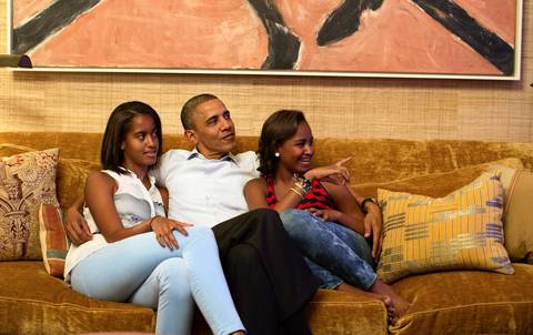 President Barack Obama and his daughters, Malia, left, and Sasha, watch on television from the Treaty Room of the White House in Washington, DC. as first lady Michelle Obama takes the stage to deliver her speech at the Democratic National Convention.