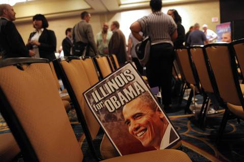Posters of Obama sit on the chairs after the Illinois delegation breakfast in Charlotte, N.C. on the second day of the DNC.