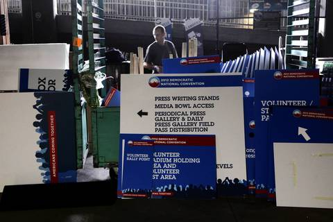DNC signage at Bank of America Stadium in Charlotte is dismantled after Democratic National Convention organizers decided to change tonight's venue to the Time Warner Cable Arena due to forecasts of rain.