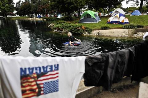 A protester rides a float in a pond at Marshall Park during the second day Democratic National Convention in Charlotte, North Carolina. The protesters gathered as the park to use it as an encampment.