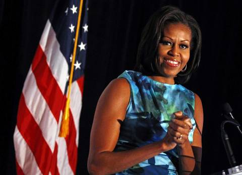 First lady Michelle Obama acknowledges applause as she arrives to speak at the Human Rights Campaign Luncheon in Charlotte, North Carolina.