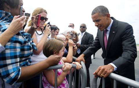 President Barack Obama greets guests upon arrival on Air Force One in Charlotte, North Carolina to attend the Democratic National Convention.