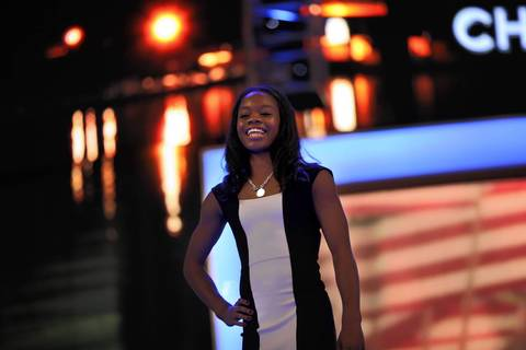 Olympic gymnast Gabby Douglas poses for the crowd before leading the Pledge of Allegiance during the Democratic National Convention at Time Warner Cable Arena in downtown Charlotte, N.C.