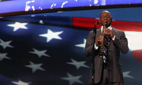 Saxophonist Branford Marsalis plays the national anthem for the start of the second day of the Democratic National Convention at Time Warner Cable Arena in downtown Charlotte, N.C.