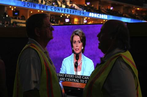 Delegates watch House Minority Leader Nancy Pelosi speak in support of President Barack Obama at the Democratic National Convention at Time Warner Cable Arena in downtown Charlotte, N.C.