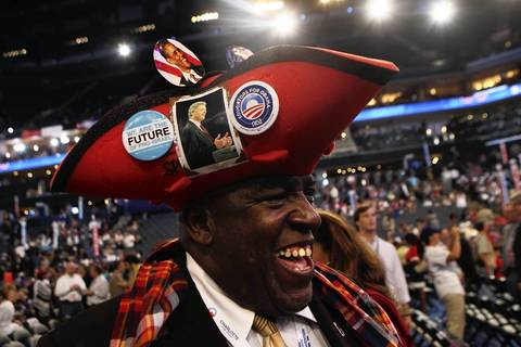 "Edgar ""Baker"" Phillips from the U.S. Virgin Islands is all smiles as he sports a special hat for the Democratic National Convention at Time Warner Cable Arena in downtown Charlotte, N.C."