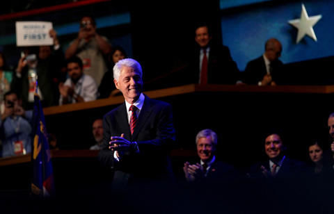 Former President Bill Clinton takes the stage to speak in support of President Barack Obama at the Democratic National Convention.