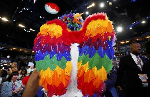 A delegate wearing wings waits for the start of the second session of Democratic National Convention.