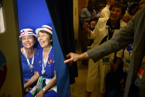 Priscilla Marquez and Evie Walls, from Arizona, pose in the Google photo booth at the Time Warner Cable Arena in Charlotte, North Carolina, ahead of events on the second day of the Democratic National Convention.