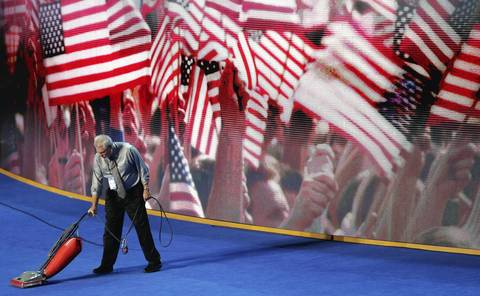 A man vacuums the stage during day two of the Democratic National Convention at Time Warner Cable Arena in Charlotte, North Carolina.