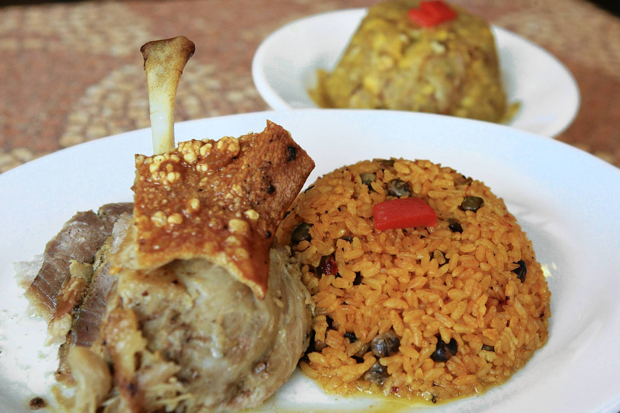 Guavate's roasted pork with rice and pigeon peas and a side order of mofongo.