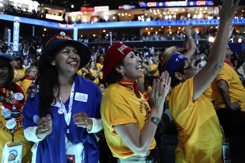 New Mexico delegates sing along as James Taylor sings performs on the last day of the Democratic National Convention.