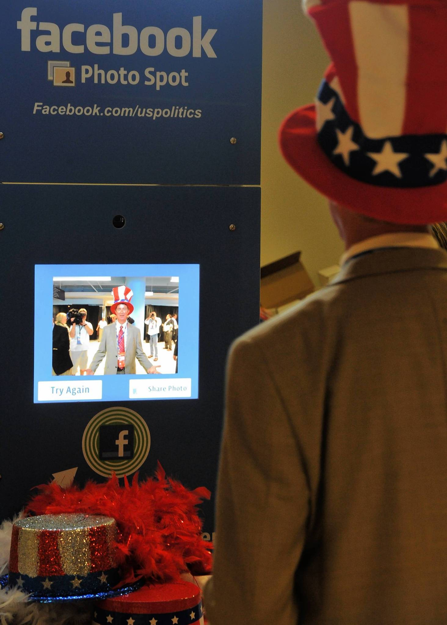 A delegate with a red, white and blue top hat poses in the Facebook photo booth at the Tampa Bay Times Forum in Tampa, Florida, on August 29, 2012 ahead of the day's Republican National Convention events.