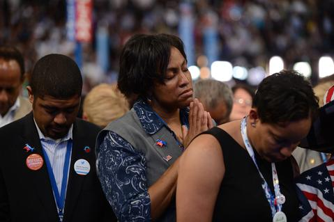 Supporters pray during an invocation on the final day of the Democratic National Convention.