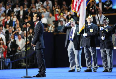 Musician Marc Anthony performs the national anthem as American Legion Post 400 of Charlotte, North Carolina presents the colors during the final day of the Democratic National Convention.