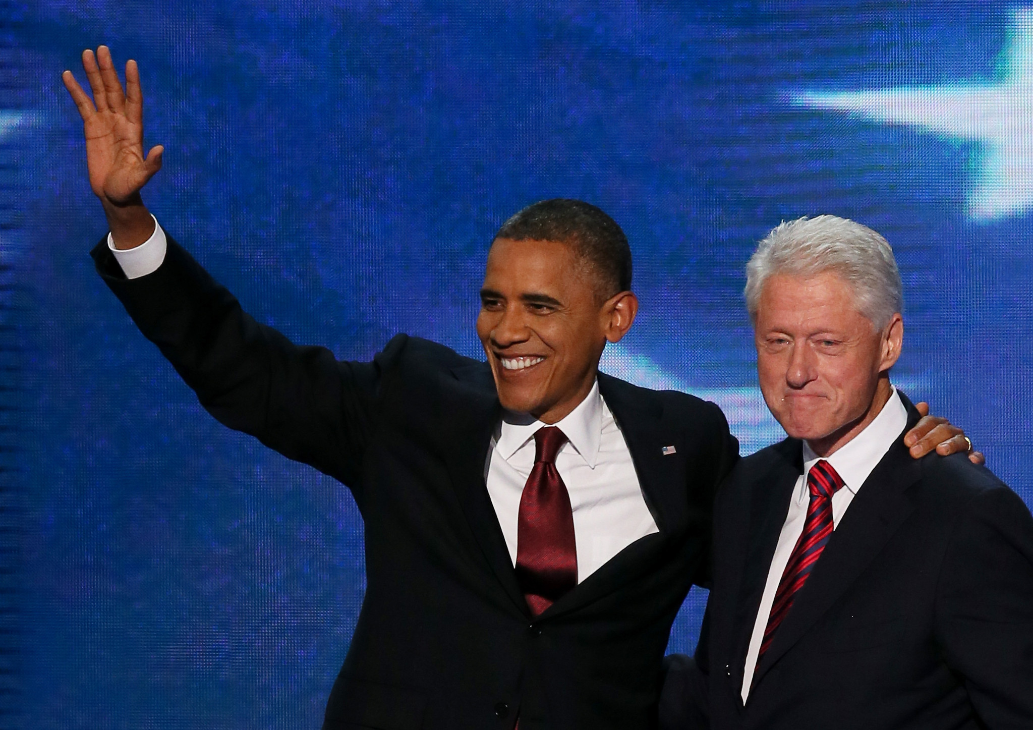 President Obama and former President Clinton on stage together after Clinton's speech at the Democratic National Convention.