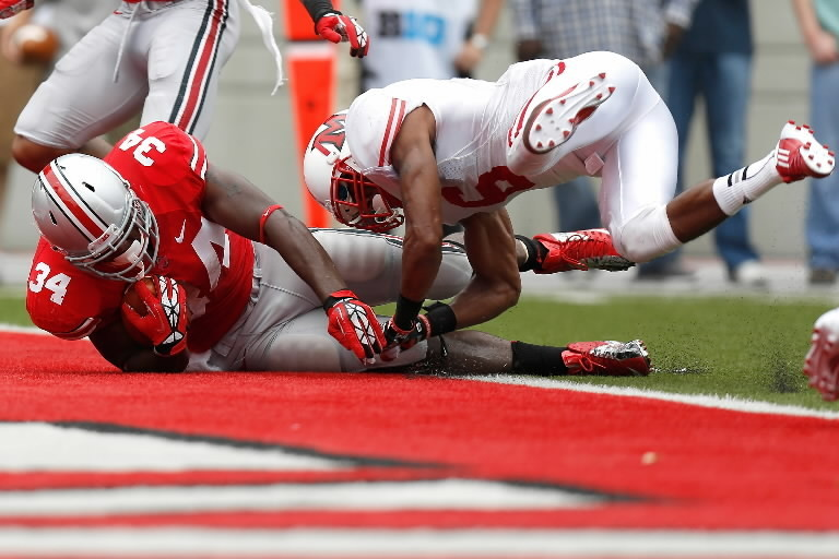 Ohio State's Carlos Hyde (34) is hit by D.J. Brown of the Miami Redhawks while diving in for a touchdown during the second quarter on September 1, 2012, in Columbus, Ohio.