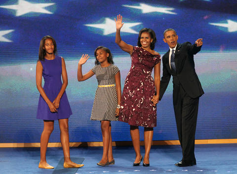(Left to right) Daughters Malia and Sasha, and first lady Michelle Obama and President Barack Obama, wave to the crowd at the Time Warner Cable Arena in Charlotte N.C., following President Obama's address to the Democratic National Convention.