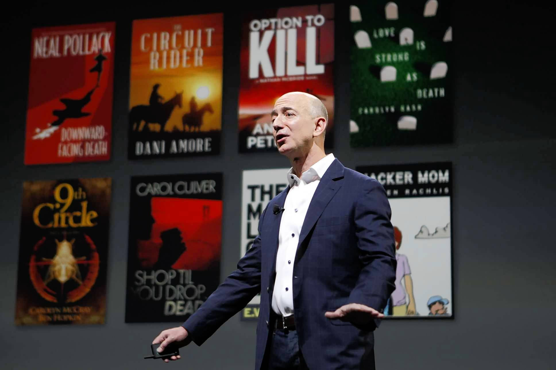 Amazon Chief Executive Jeff Bezos unveils the Kindle Paperwhite this week. A court's approval of a settlement benefiting Amazon in an e-book price-fixing case has the publishing world in turmoil.